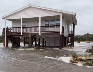OAK ISLAND, NC storm surge and flood damage insurance claim.