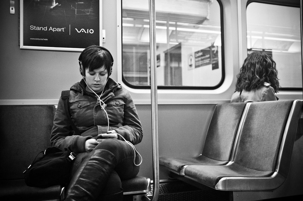 DE_VICE: Listening      Ever since  Zack Arias  shared his street photos of people wrapped up in their devices in NYC this summer, I've been fascinated by how much we isolate ourselves in public (I'm often guilty of this as well). To capture these moments is to truly capture this era.