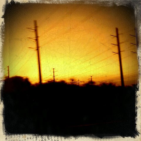Retro Camera photography of powerlines at sunset off the highway