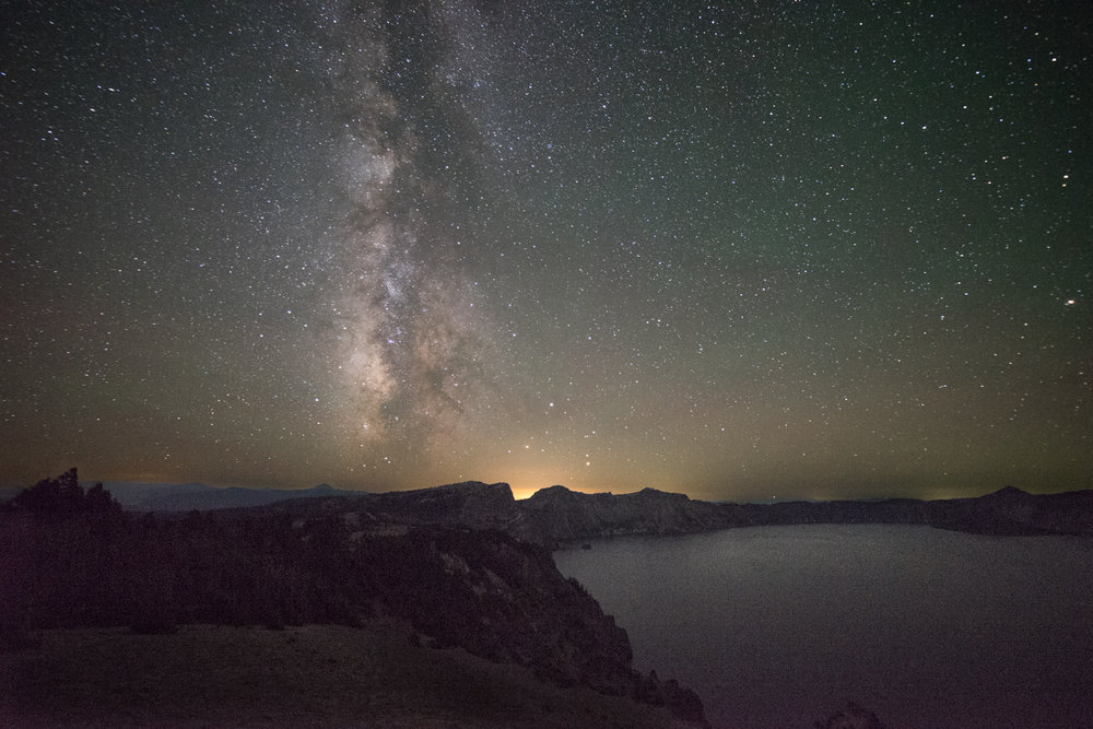 The Milky Way rises over Crater Lake.  The Galactic Center is visible in this photo.