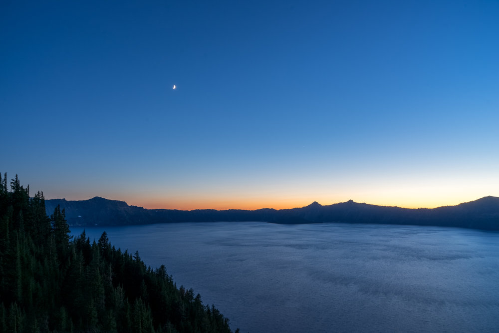 Sunset over the Crater Lake rim.  Crater Lake is nearly 5 miles across and 2000 feet deep.  There are no rivers or streams that feed it.  All the water comes from  the 500 inches of snow it gets each year!
