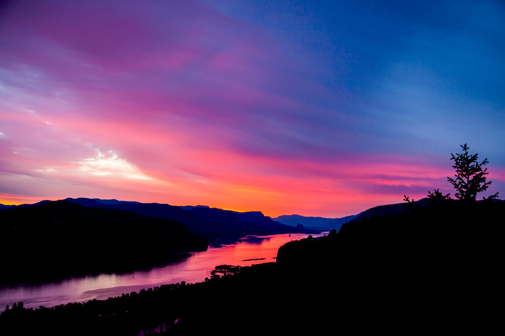 The Columbia River on fire from a brilliant sunrise.  My viewpoint is Portland Women's Forum State Scenic Viewpoint.