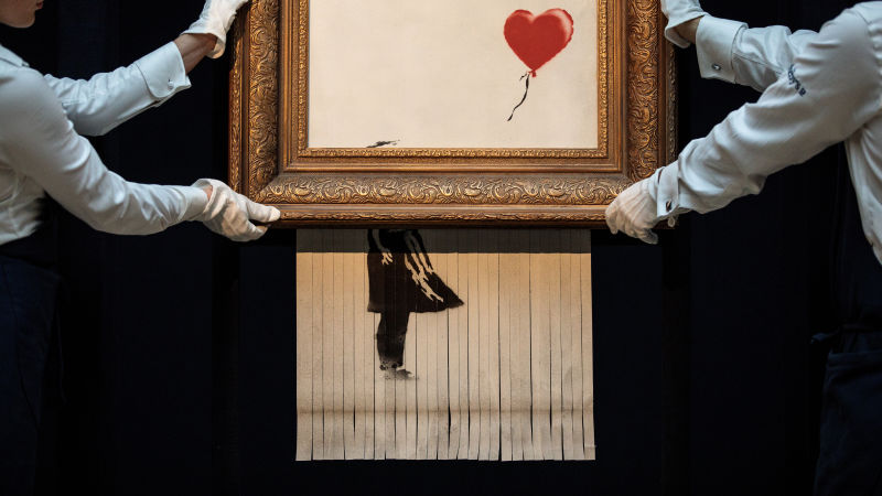 """""""Girl with Balloon""""  by anonymous street artist and activist  Banksy"""