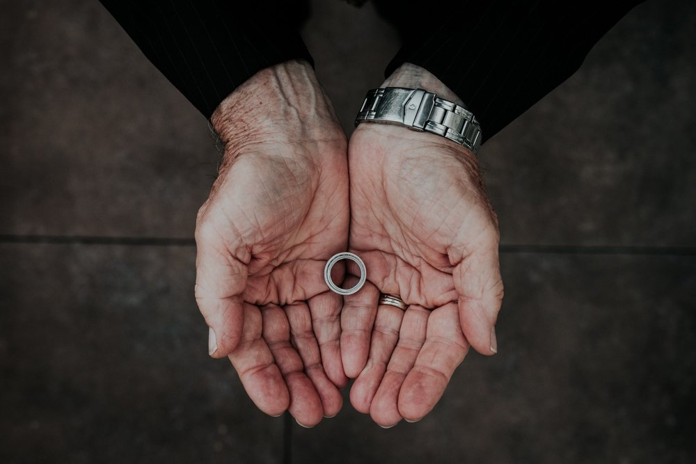I shot this at a recent  Fort Co.  wedding, and I use it here with the newlyweds' permission. Their grandfather made these wedding bands, by hand, with no prior knowledge of ring-making. He told me it was all a labor of love.