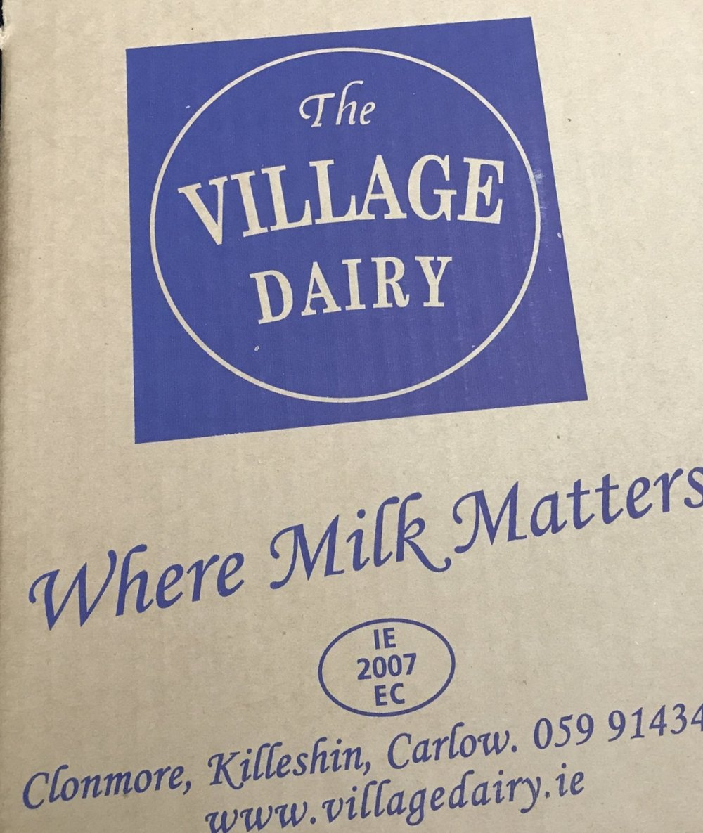 Village Dairy logo