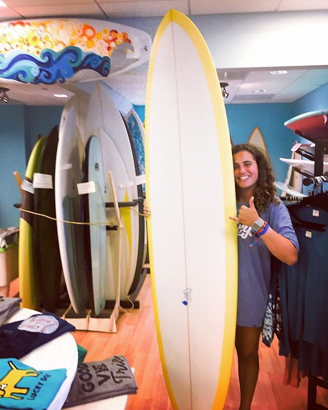 Surfer chick is all smiles! Speed Egg by the one and only Tom Eadon #localshaper #surfshop #seabright @luckydogsurf