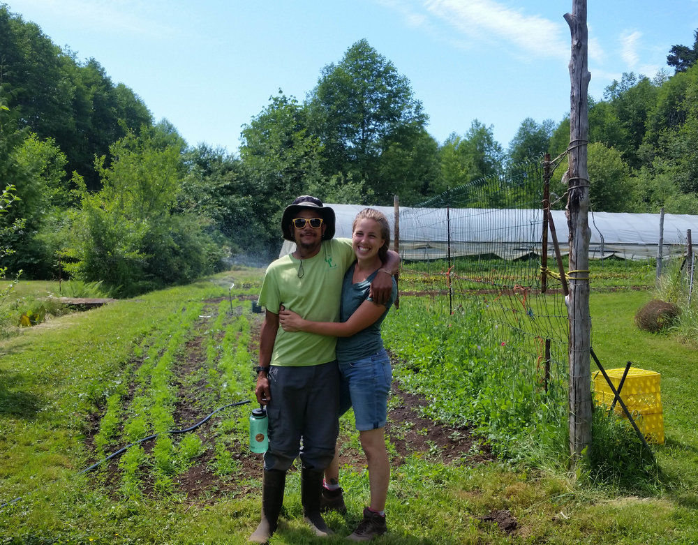 Team Clam in front of our beloved patch of carrots on Vancouver Island