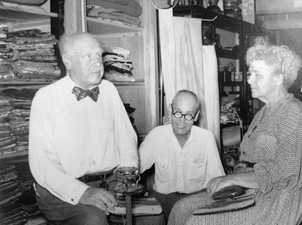 My grandfather with 2 customers.