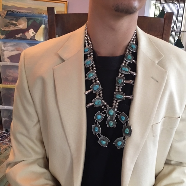 Stunning. This beautiful squash blossom necklace is Native American, and can be easily worn by either men or women.. Price group B.