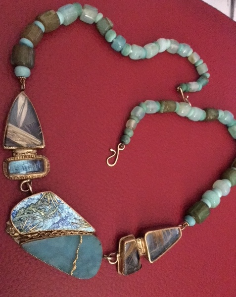 A custom piece by Marianne Hunter of Southern California. Marianne uses stone, enamel and exquisite creative imagination to explore the natural wonders and mix history in with contemporary jewelry.Each piece is inscribed on the back by her.  This necklace was purchased at past ACA show at Fort Mason.