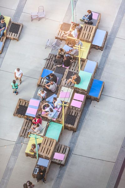 Make a meet/hang/lunch spot from painted pallets - Image via Pinterest