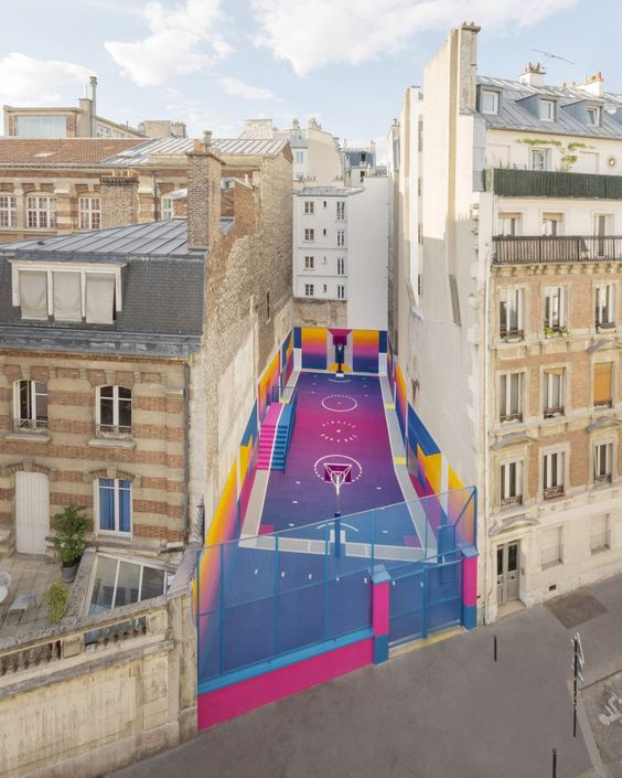 Turn a laneway into a colourful basketball court - Image via Colossal