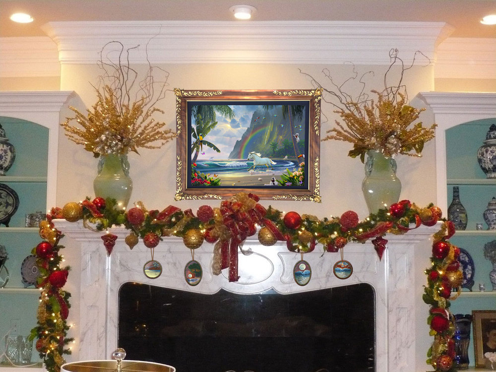 Christmas heirloom Koawood ornaments displayed on a fireplace hearth in a privet collection