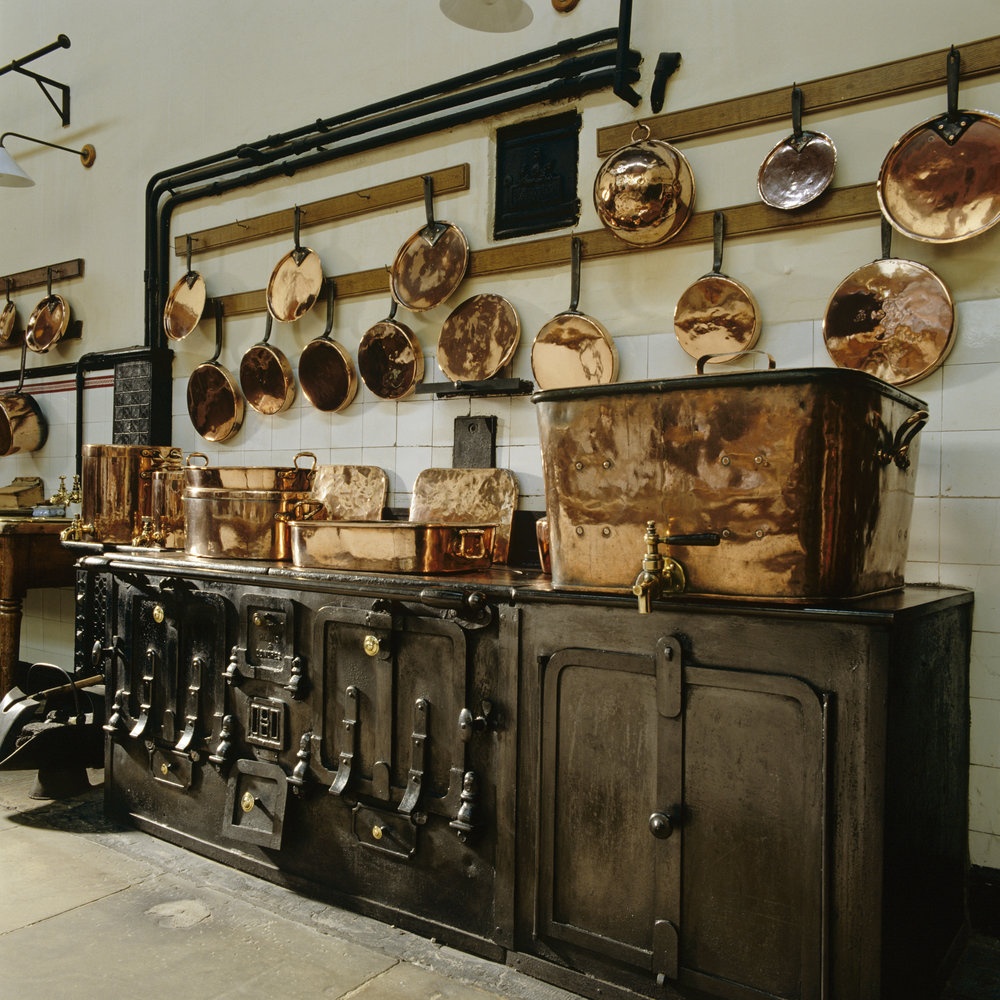 The kitchen at Lanhydrock, Cornwall - Copper containers sit on the range ©National Trust Images Andreas von Einsiedel