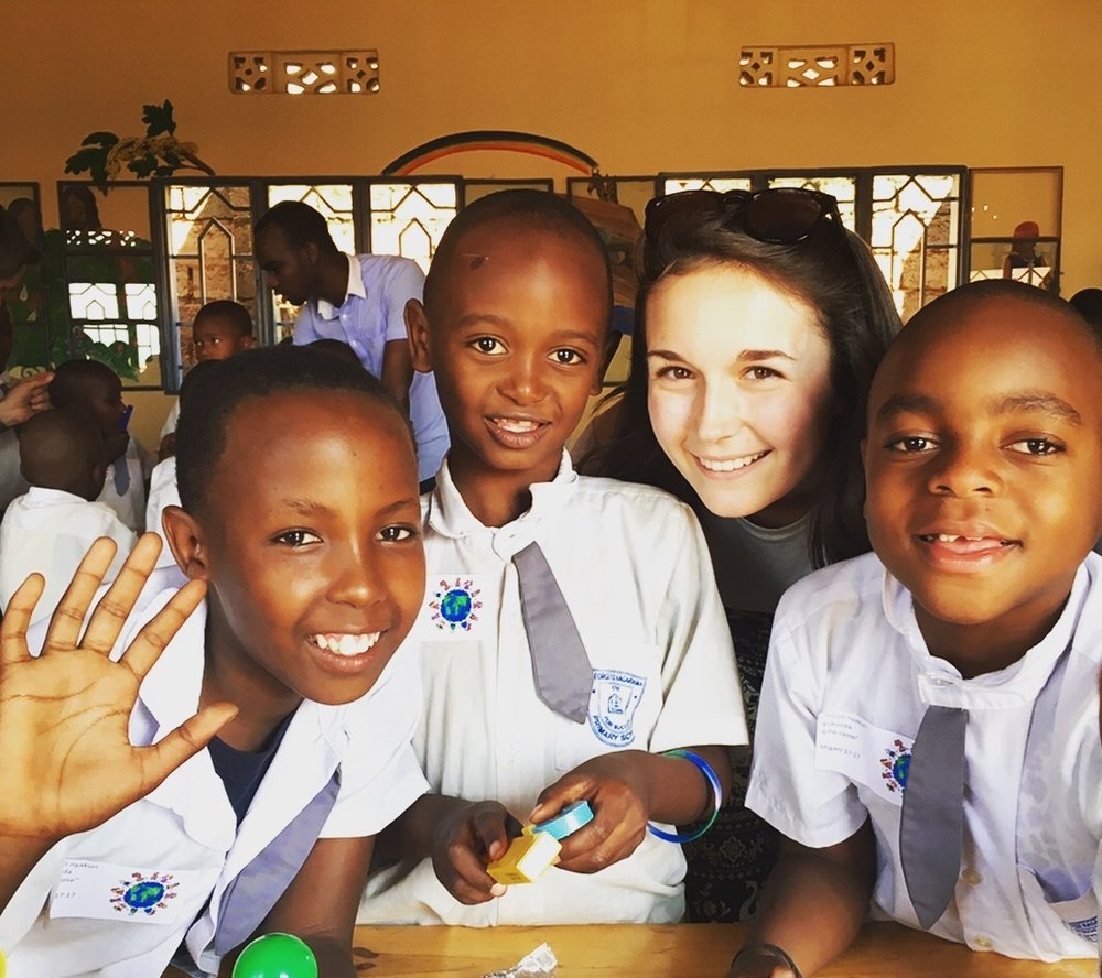 Sydney with three of Africa New Life's DreamKids during her trip to Rwanda in July 2017.