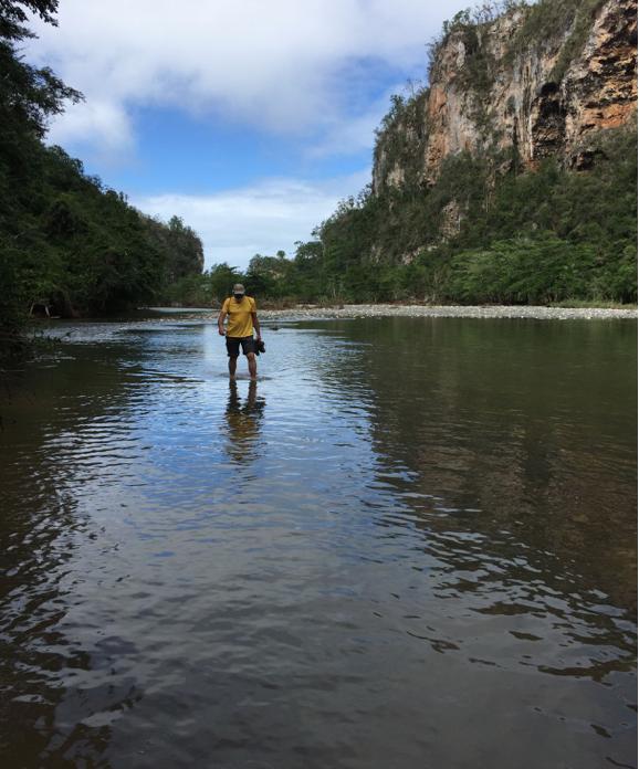 Barefoot trekking in Yumuri River, near Baracoa, Cuba, 2016