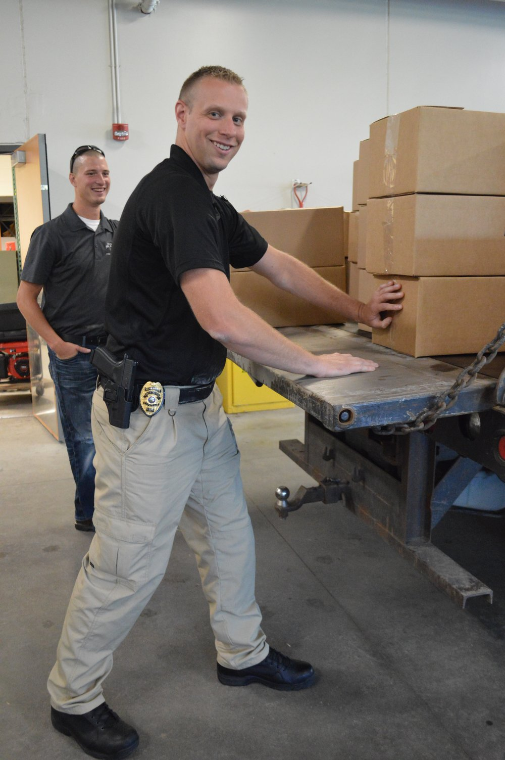Sauk Rapids Police Officer Nicholas Bogart and Benton Soil and Water Conservation District Watershed Technician Travis Janson loading up the truck with the pharmaceutical waste for transportation to the Pope/Douglas Solid Waste Management facility in Alexandria.    Photo Credit to Benton County News