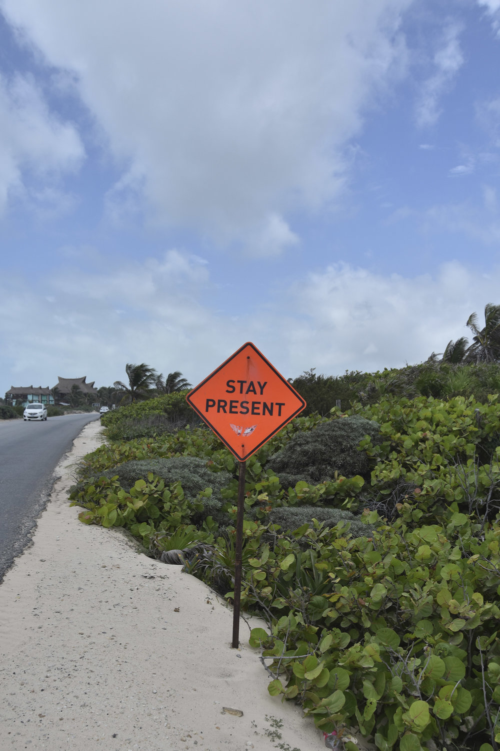 stay-present-tulum-road-sign