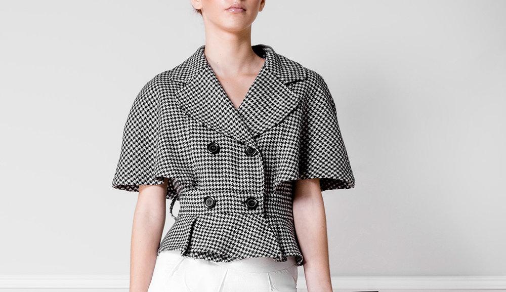 Chaqueta tweed blanco y negro - €210