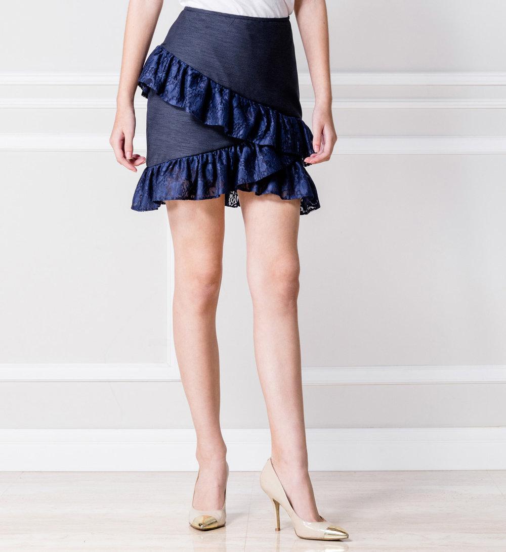 Mini falda azul con volantes - €75