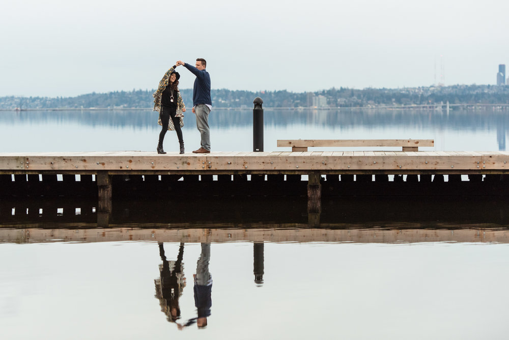 Jenny and John Fun and Light Outdoors Documentary Engagement Portrait at Waverly Park in Kirkland washington