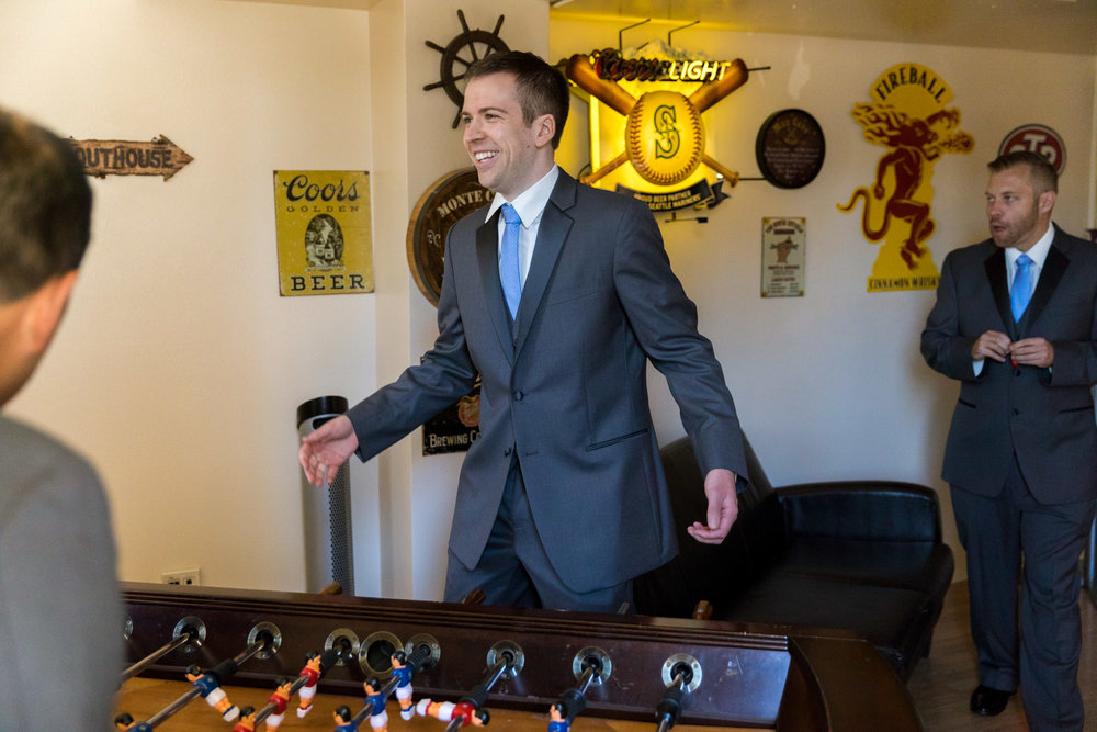 Groomsmen Playing Foosball