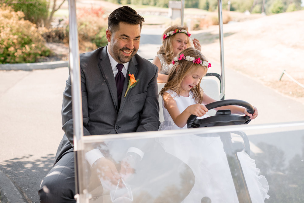 Flower Girls and Groomsman Drive around in Golf Cart
