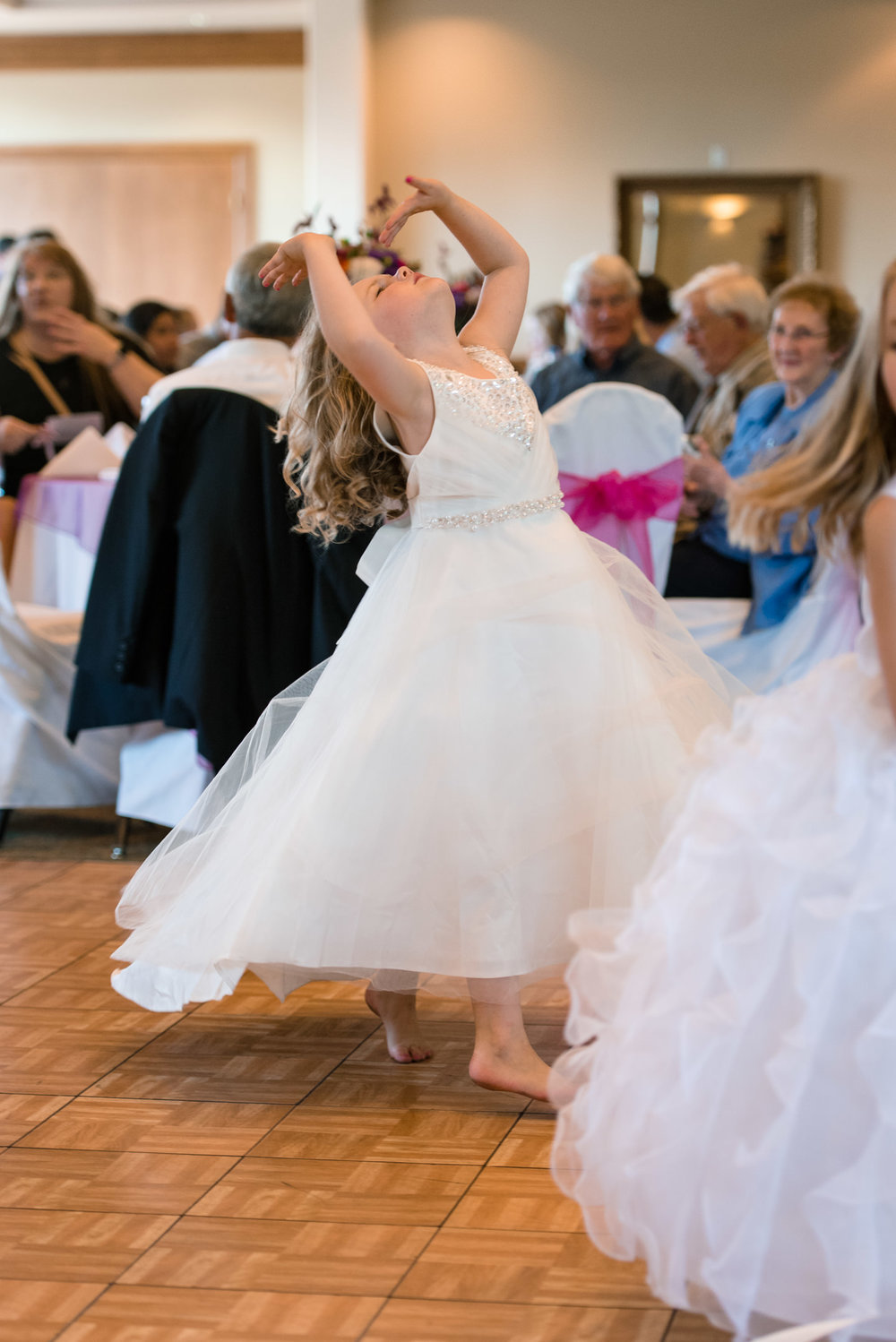 Flower Girl Dancing during Wedding Reception at Echo Falls Golf Course