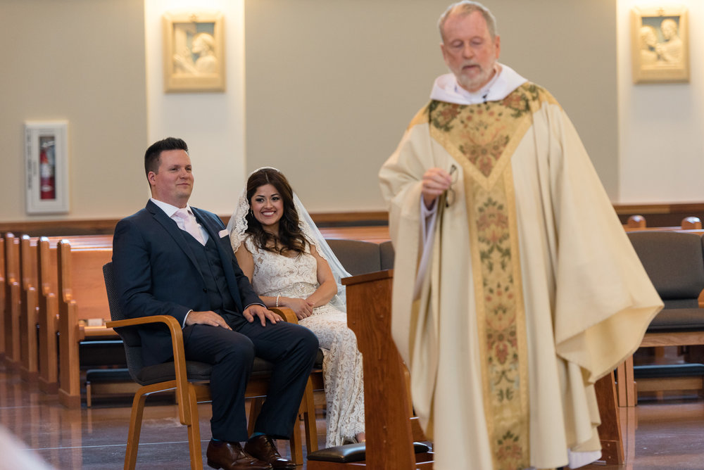 Salvadoran Bride and Groom Laugh with Priest