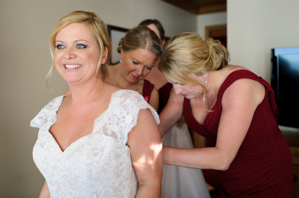 Bridesmaids Helping Bride Get Ready at Edgewater Hotel