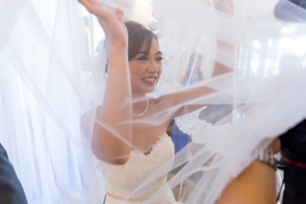 Bride Fun with Veil during Wedding Reception