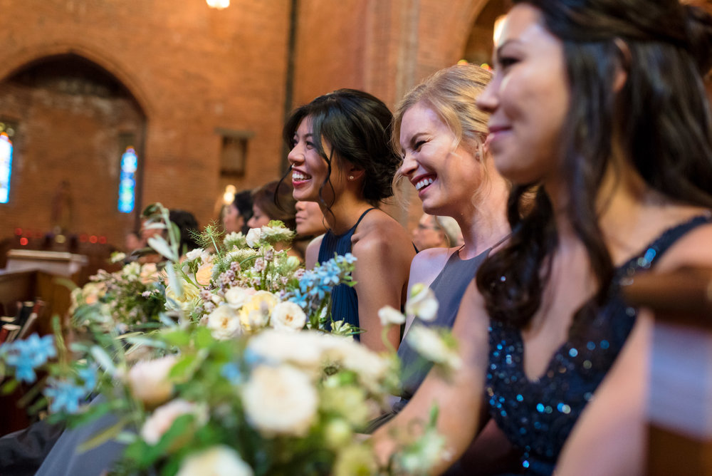 Bridesmaids Happy Laugh during Wedding Ceremony