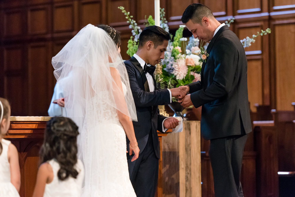 Best Man Gives Asian Groom Wedding Rings during Ceremony