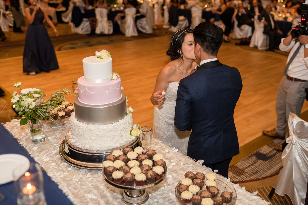 Asian Bride and Groom Kiss after Cake Cutting at Olive 8