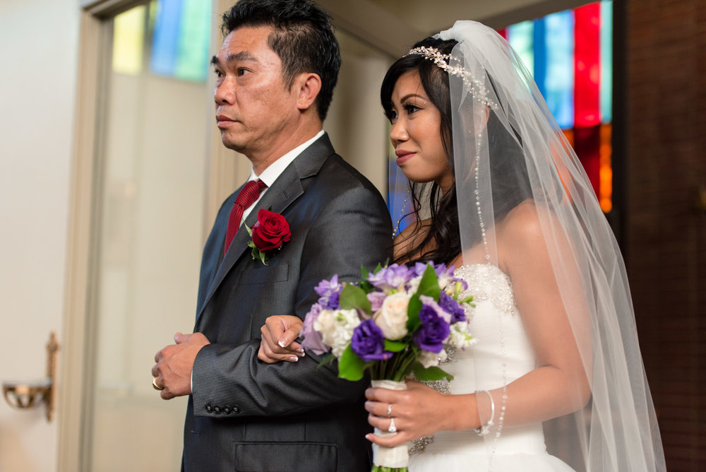 Asian Bride and Father Walk Down Aisle during Wedding Ceremony