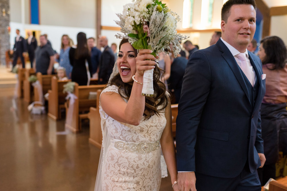 Salvadoran Bride and Groom Walk Down Aisle at Wedding Ceremony