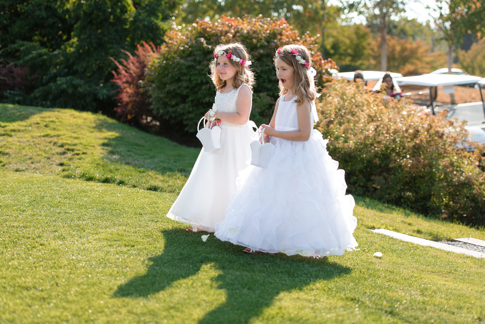 Flower Girls Walk Down Aisle at Wedding Ceremony