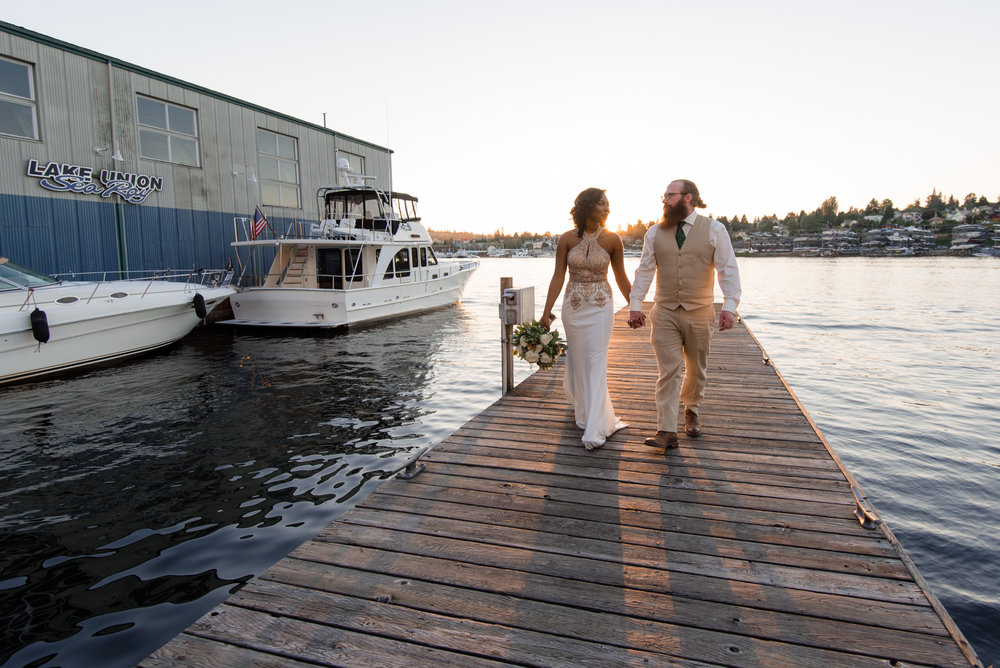 Bride and Groom Walk On Dock at Tyee Yacht Club