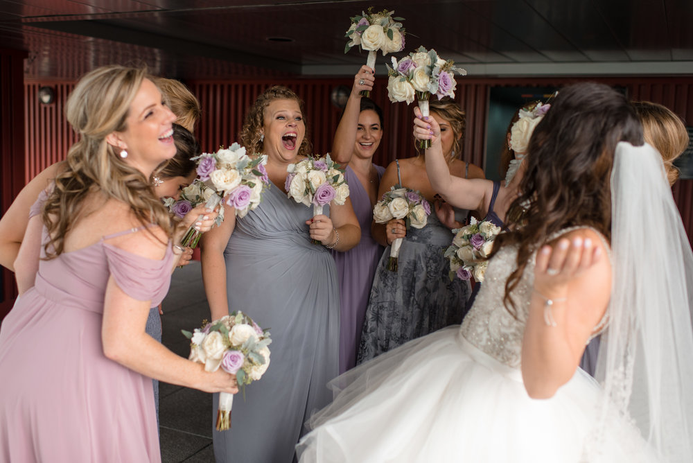 Bride and Bridesmaids Laughing and Having Fun