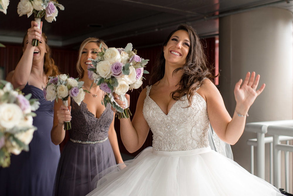 Bride and Bridesmaids Laughing Dancing and Having Fun