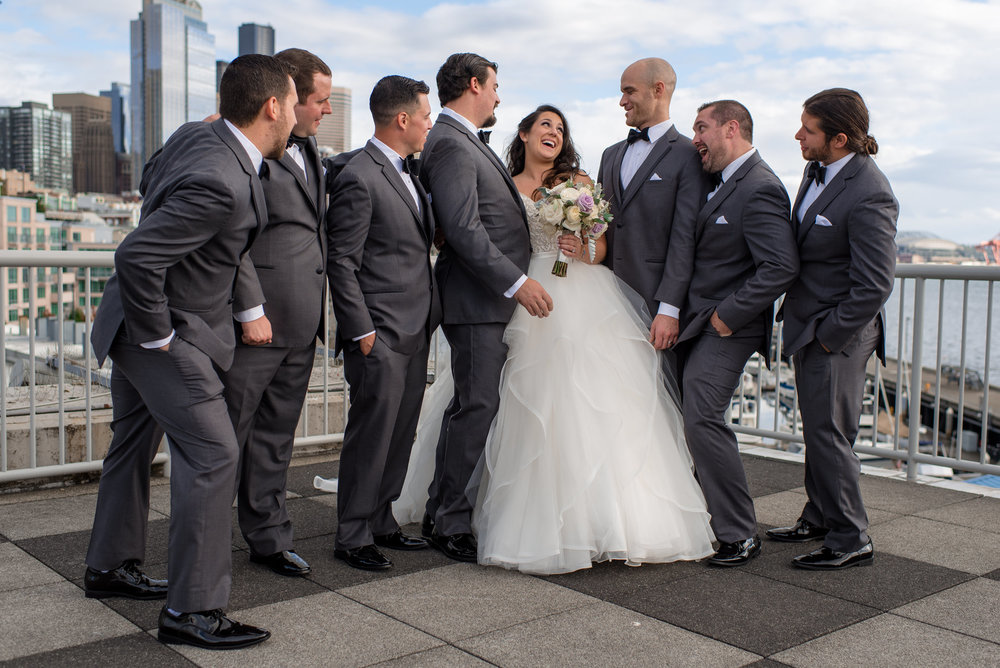 Bride and Groomsmen Laughing Wedding Portrait with Seattle Water