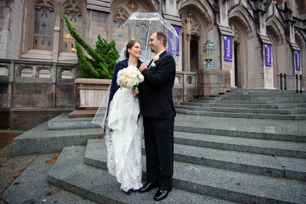 Bride and Groom Cuddle at Suzzallo Library