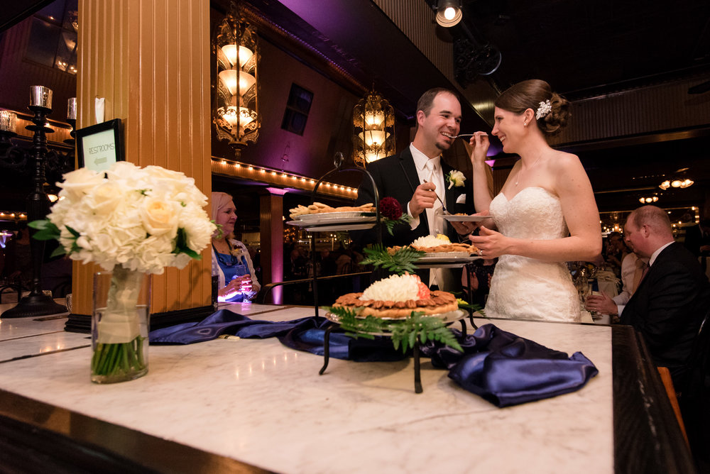 Bride and Groom Cut and Eat Cake at Lake Union Cafe