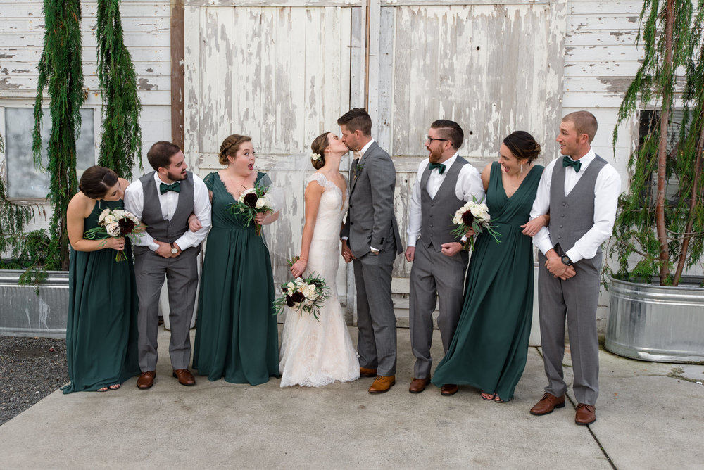 Bride and Groom Kiss during Wedding Party Portraits