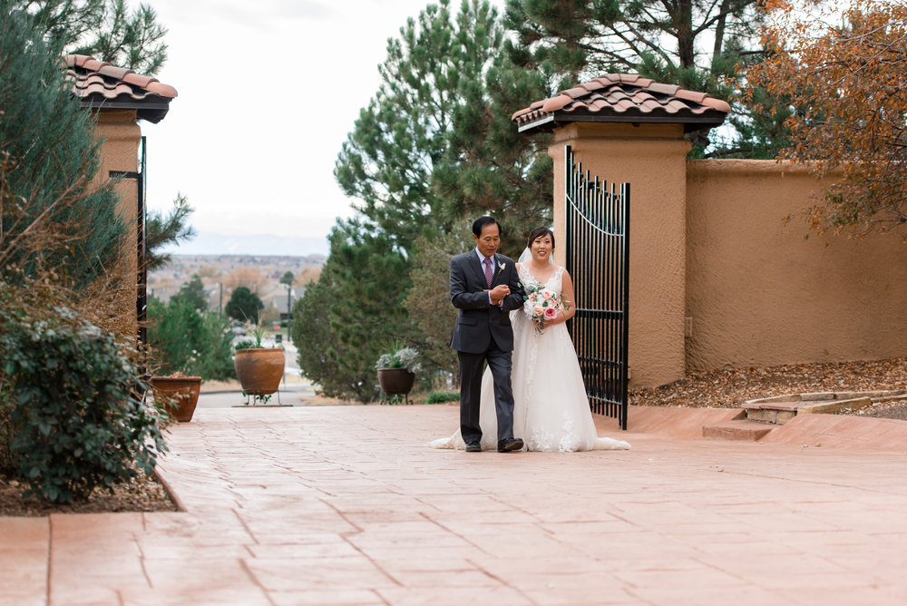 Asian Bride and Father Walk into Wedding Ceremony at Villa Parke