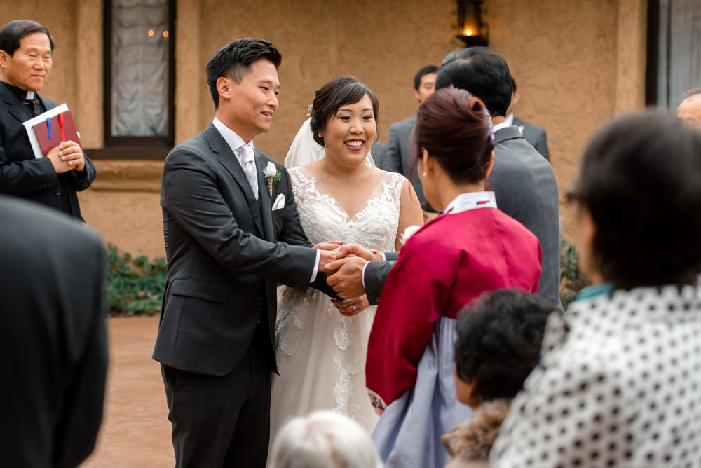 Asian Bride and Groom Thank Parents during Wedding Ceremony