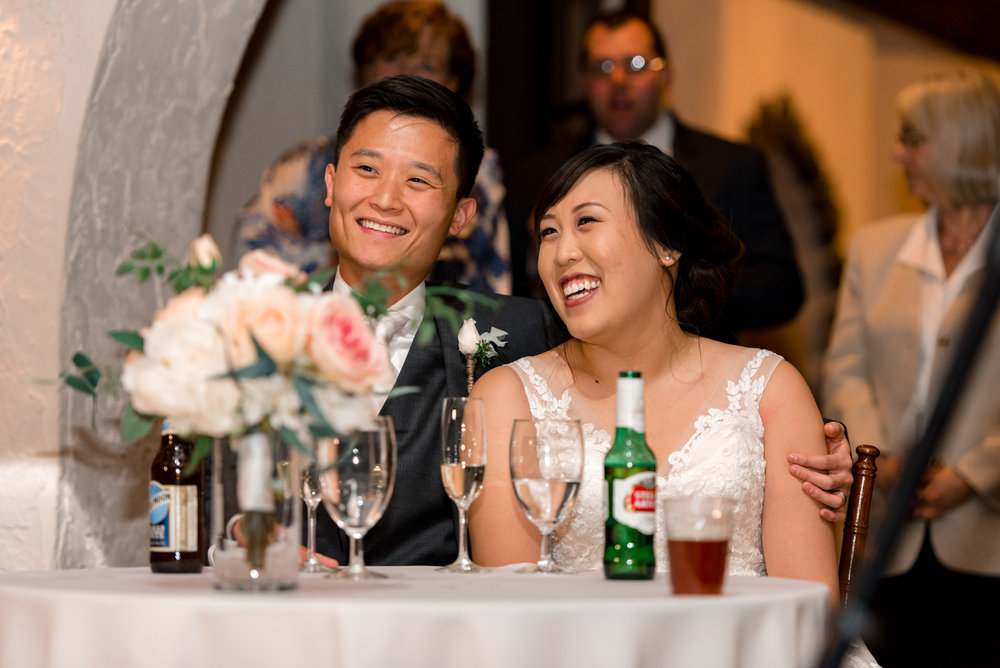 Asian Bride Groom Happy Laugh during Wedding Toast