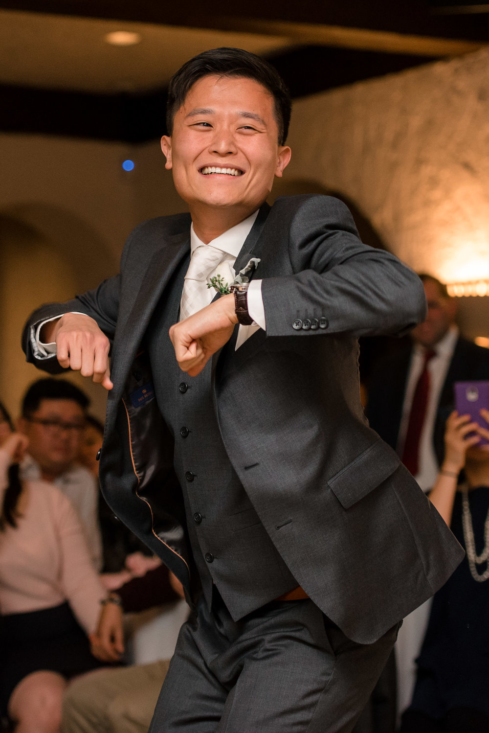 Asian Groom Dancing during Wedding Reception at Villa Parker