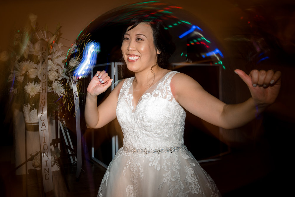 Asian Bride Dancing during Wedding Reception at Villa Parker