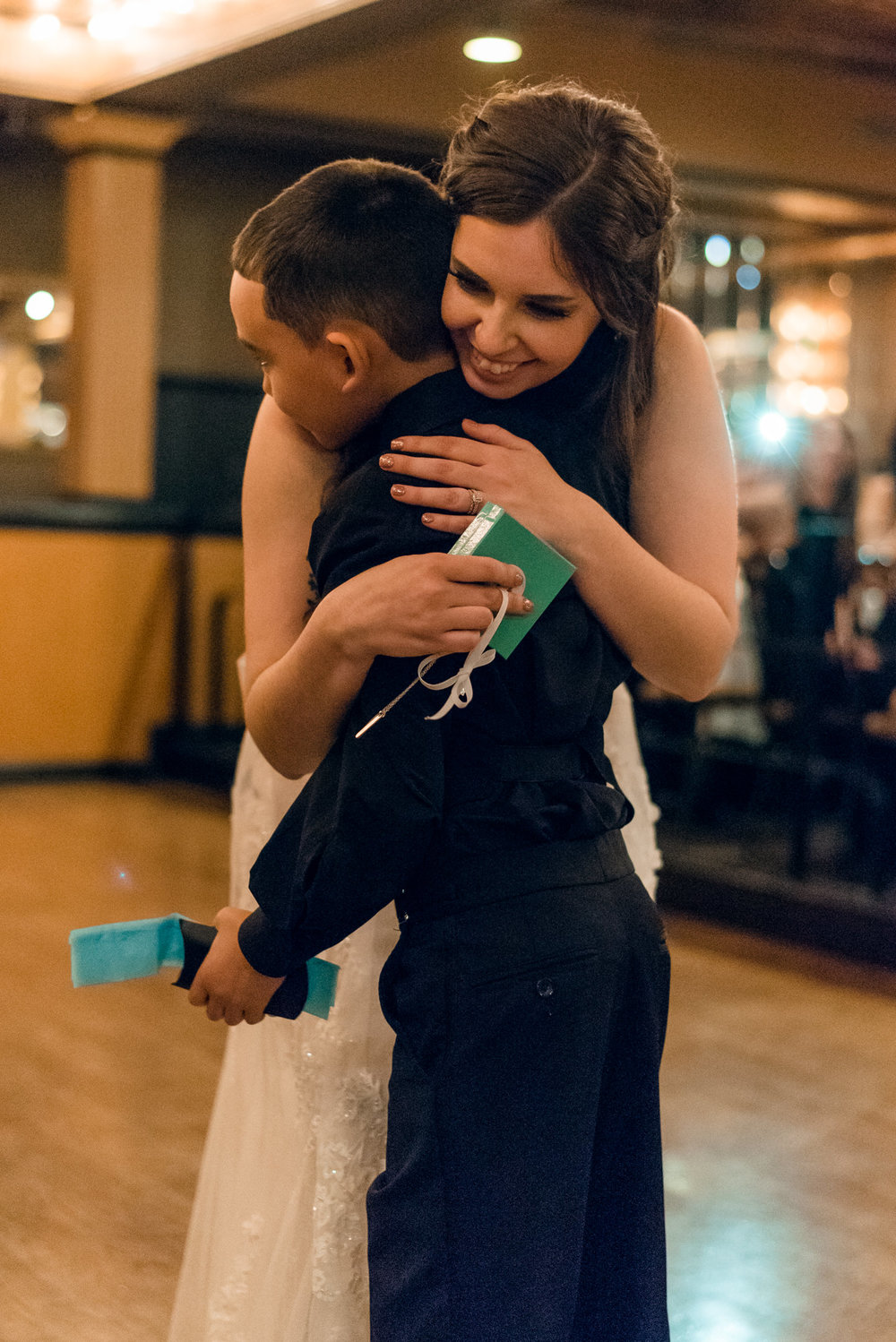 Bride Hugs Groom's Son at Lake Union Cafe